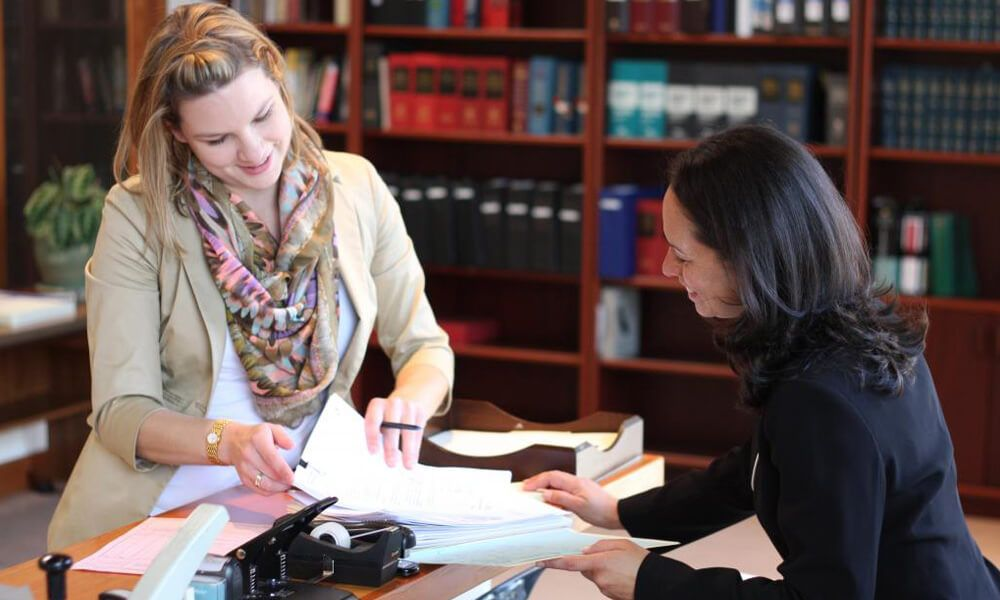 lawyers reviewing documents at administrative law firm