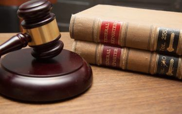 gavel and law books in an administrative law firm